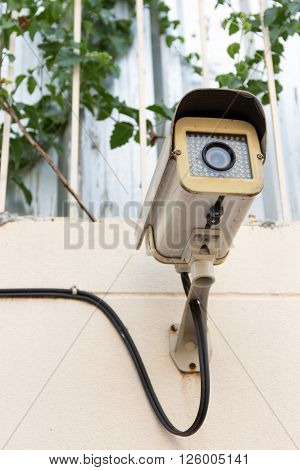 The Old CCTV Security Camera operating long time on wall
