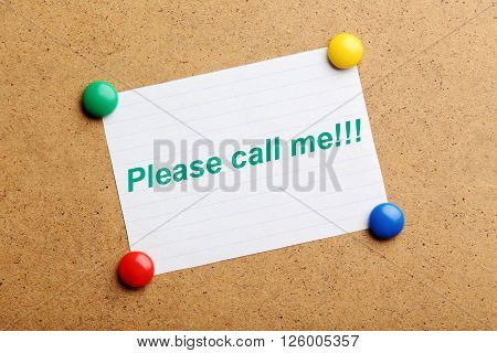 Sheet of paper on brown wooden background, please call me
