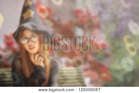 sweet dreamy with ring Bokeh portrait of Asian woman on black dress look like pretty witch sit in garden de-focused and vintage tone