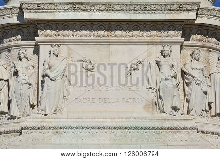 Inscription with dedication to Italian king Vittorio Emanuel II among statues of Italian cities from Vittoriano monument pedestal (1911) Translation: