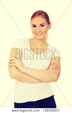 Happy young woman wiyh folded arms