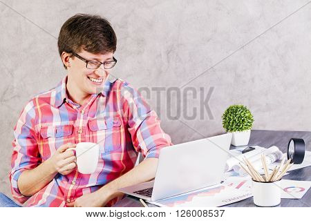 Smiling Man Looking At Screen