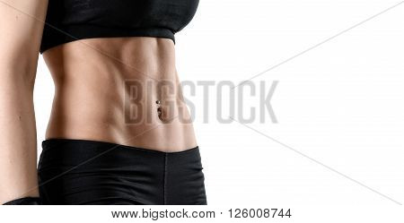 Cropped image torso of woman. Perfect abdominal muscles of fit female model isolated on white background.