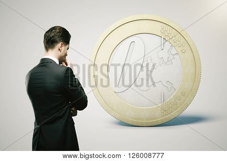 Financial concept with thinking businessman looking at zero euro coin on light grey background. 3D Rendering