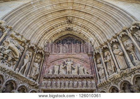 The tympanum of Christ redeemer (Cristo Redentor) in the principal facade of San Bartolome church in Logroño La Rioja. Spain.