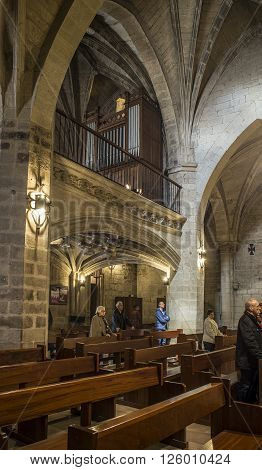 Logroño Spain - April 9 2016. Parishioners in nave of San Bartolome church in Logroño La Rioja. Spain.