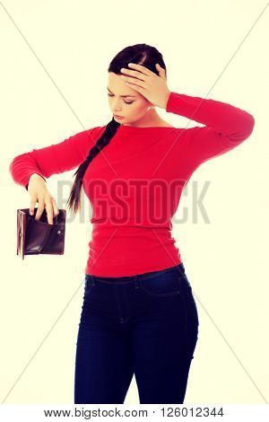 Young student woman holding empty wallet