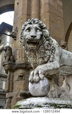 Marble lion statue at the entrance (left side) of Loggia dei Lanzi in Florence made by artist Flaminio Vacca in 1598