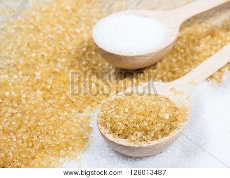 Brown Sugar Cane On The Wooden Background.