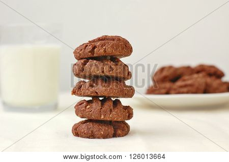 Cocoa Biscuits On The Plate Withe Glass Of Milk