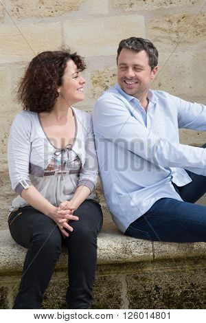 Middle Aged Couple Sitting And Looking To Each Other