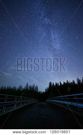 Bridge To The Stars On Night Sky