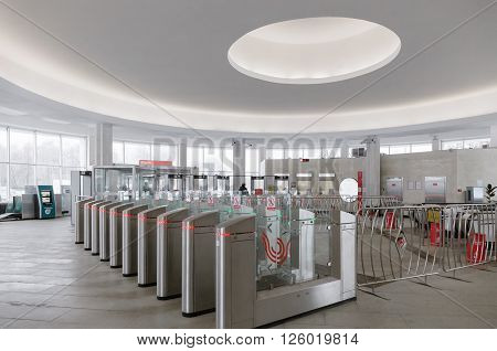 MOSCOW - MARCH 3: Modern turnstiles on an entrance to the Botanichesky Sad metro station on March 3 2016 in Moscow. Lobby of Botanichesky Sad metro station was completely reconstructed in 2015.