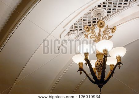 MOSCOW - MARCH 3: Chandeliers in Arbatskaya metro station on March 3, 2016 in Moscow. Arbatskaya was designed by Leonid Polyakov, Valentin Pelevin and Yury Zenkevich and build in 1953.