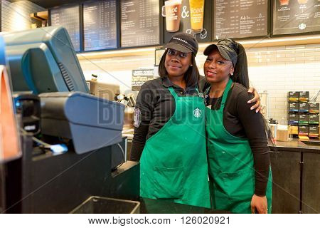 NEW YORK - CIRCA APRIL 2016: workers at Starbucks Cafe. Starbucks Corporation is an American global coffee company and coffeehouse chain based in Seattle, Washington