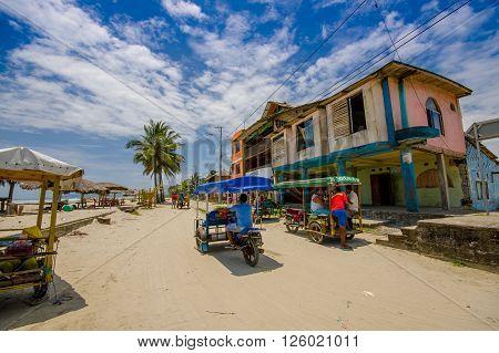 Muisne, Ecuador - March 16, 2016: Buildings in the center of the city, main street, in the coast of Ecuador.