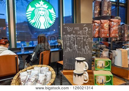 NEW YORK - CIRCA MARCH 2016: inside of Starbucks Cafe. Starbucks Corporation is an American global coffee company and coffeehouse chain based in Seattle, Washington