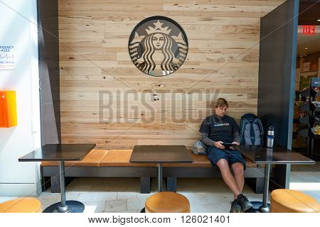 NEW YORK - APRIL 06, 2016: logo of Starbucks Cafe. Starbucks Corporation is an American global coffee company and coffeehouse chain based in Seattle, Washington