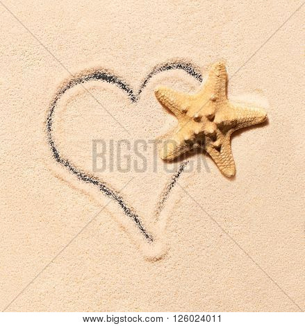 Starfish And Heart Drawn On Sand