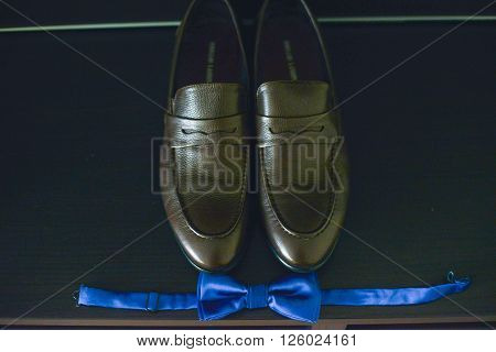 Shoes Stacked In Composition On A Black Desk