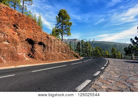 Mountain road to volcano Teide among rocky mountains on Tenerife island, Spain