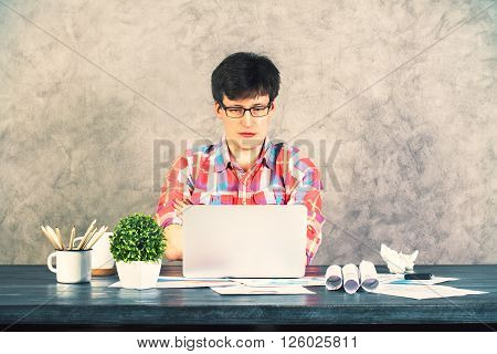 Focused Man Using Laptop Front