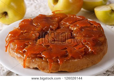 Apple Tarte Tatin With Caramel Close-up On A Plate. Horizontal