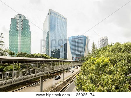 Jakarta Indonesia - March 19 2016: Panorama of Jakarta skyscrapers at cloudy day