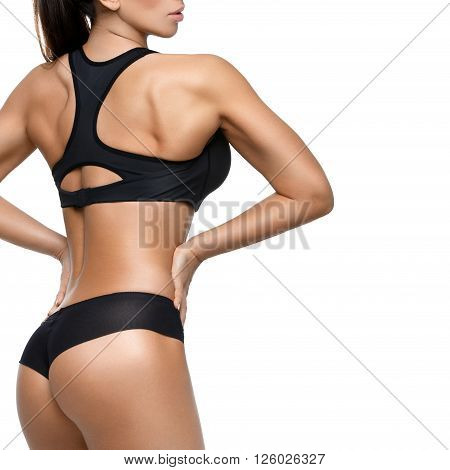Sporty fit beautiful woman with muscle relief. Isolated over white  backgound. Square composition. Copy space.