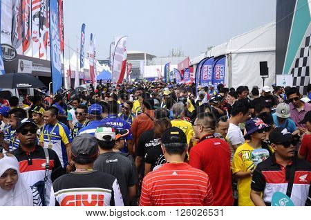 SELANGOR, MALAYSIA -OCTOBER 25, 2015:  People walk in the exhibition and sale gallery during the MotoGP 2015 competition in Sepang, Malaysia.