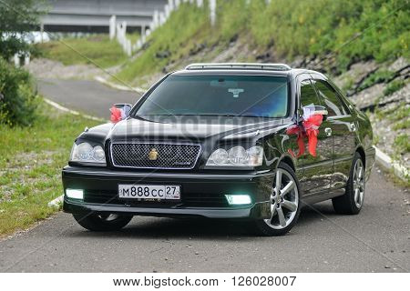KHABAROVSK, RUSSIA - August 28, 2015 : Toyota Crown   decorated for wedding walk