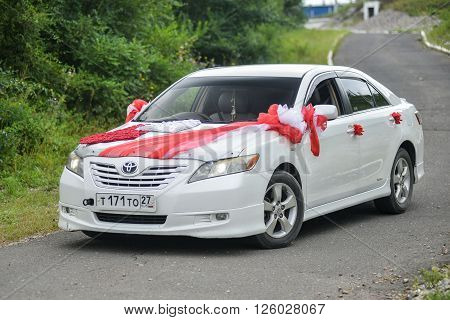 KHABAROVSK, RUSSIA - August 28, 2015 : Toyota Camry   decorated for wedding walk