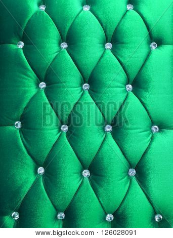 Green upholstery velveteen decorated with crystals as texture and pattern