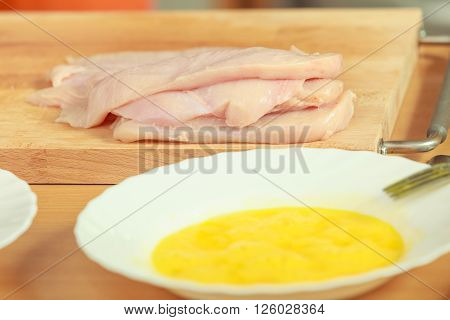 Food preparing cooking concept. chicken breast meat on wooden board close up