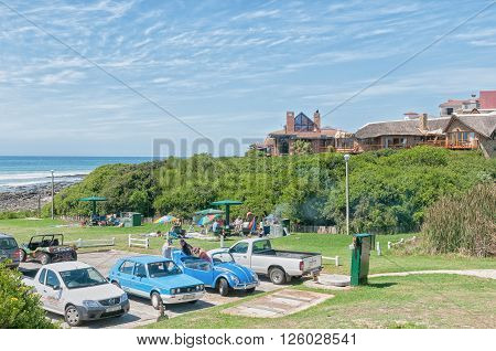 JEFFREYS BAY SOUTH AFRICA - FEBRUARY 28 2016: Unidentified tourists relaxing at Lower Point in Jeffreys Bay in the Eastern Cape Province of South Africa
