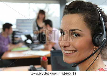 Portrait of a smiling telemarketer