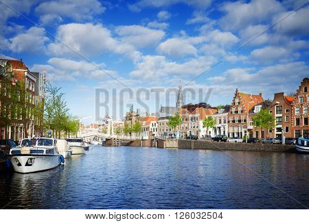Spaarne river and old town in Haarlem, Netherlands, toned