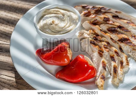 Grilled Chicken With Stuffed Peppers And Tahini Sauce