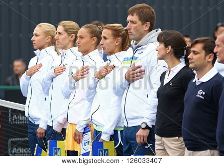 KYIV UKRAINE - APRIL 16 2016: Ukraine National Team listen national anthem before BNP Paribas FedCup World Group II Play-off game Ukraine vs Argentina at Campa Bucha Tennis Club in Kyiv Ukraine
