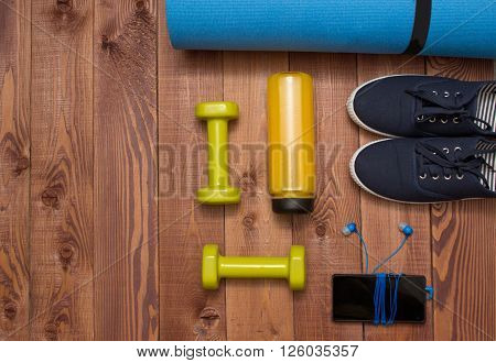 Sport Accessories: Clothes, Shoes, Weights, Bottle, Phone On Wooden Background