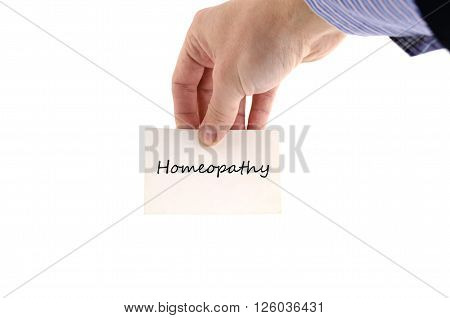 Homeopathy text note in business man hand