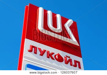 SAMARA RUSSIA - APRIL 16 2016: The emblem of the oil company Lukoil against the blue sky background. Lukoil is one of the largest russian oil companies