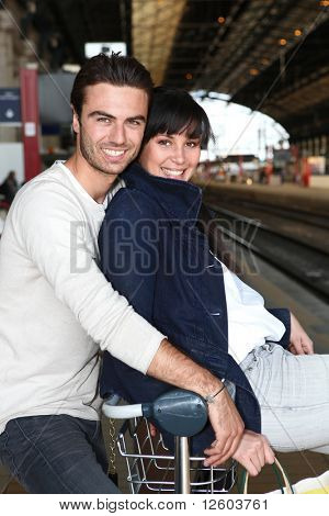 Young couple at train station