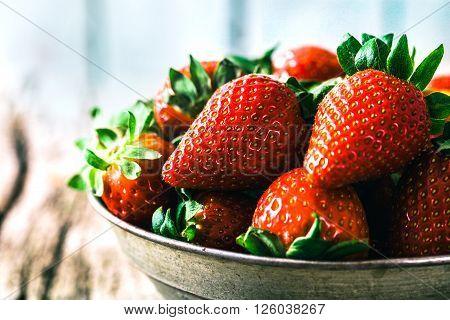 Fresh fruit. Strawberries on wood. Spring fruit.