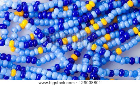 Blue beads necklace close up as a background