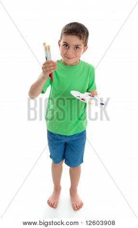 Standing Boy Holding Paints And Brushes