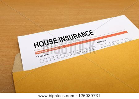 House Insurance application form on brown envelope