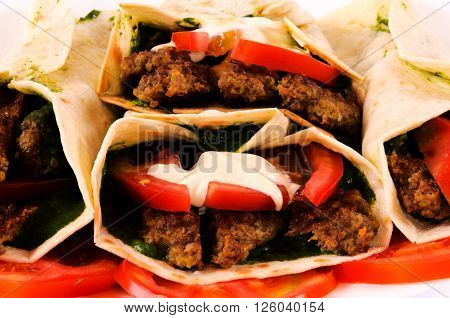 Bunch of gyros pita and vegetables on rustic background