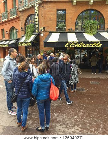 TOULOUSE - APRIL 17: Customers queue in a line outside the Entrecote Steak Restaurant on April 17, 2016 in Toulouse, France.