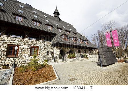 ZAKOPANE POLAND - MARCH 06 2016: Massive hotel building named Aries Hotel & Spa came into use in 2014. Previously in this building built in 1958 it housed the legendary Tourist House